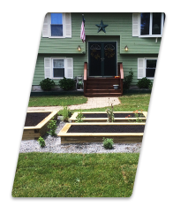 manicured lawn with boxes and mulch